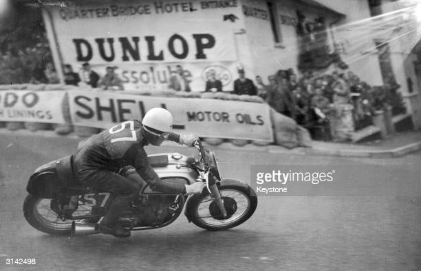 Geoffrey Duke taking the Quarter Bridge at high speed during the Isle of Man Senior TT Race which he won with a record speed of 92.27 mph on his...