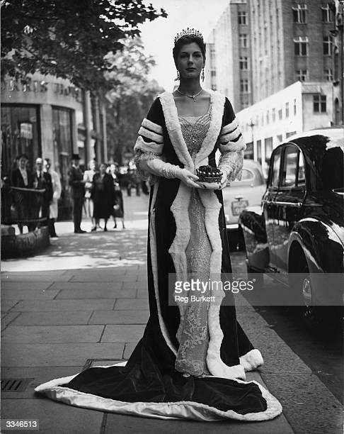 Former model Fiona Baroness Thyssen modelling the gown she will wear at the Coronation ceremony of Queen Elizabeth II during a trade display of...