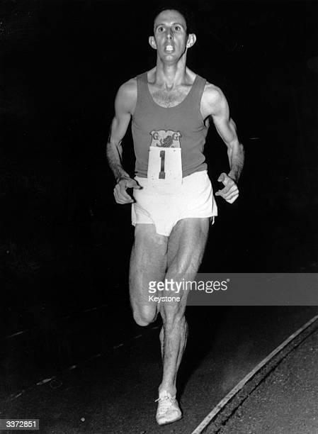 Australian middledistance runner John Landy running a mile in 4 minutes 16 seconds at Stockholm Stadium Sweden