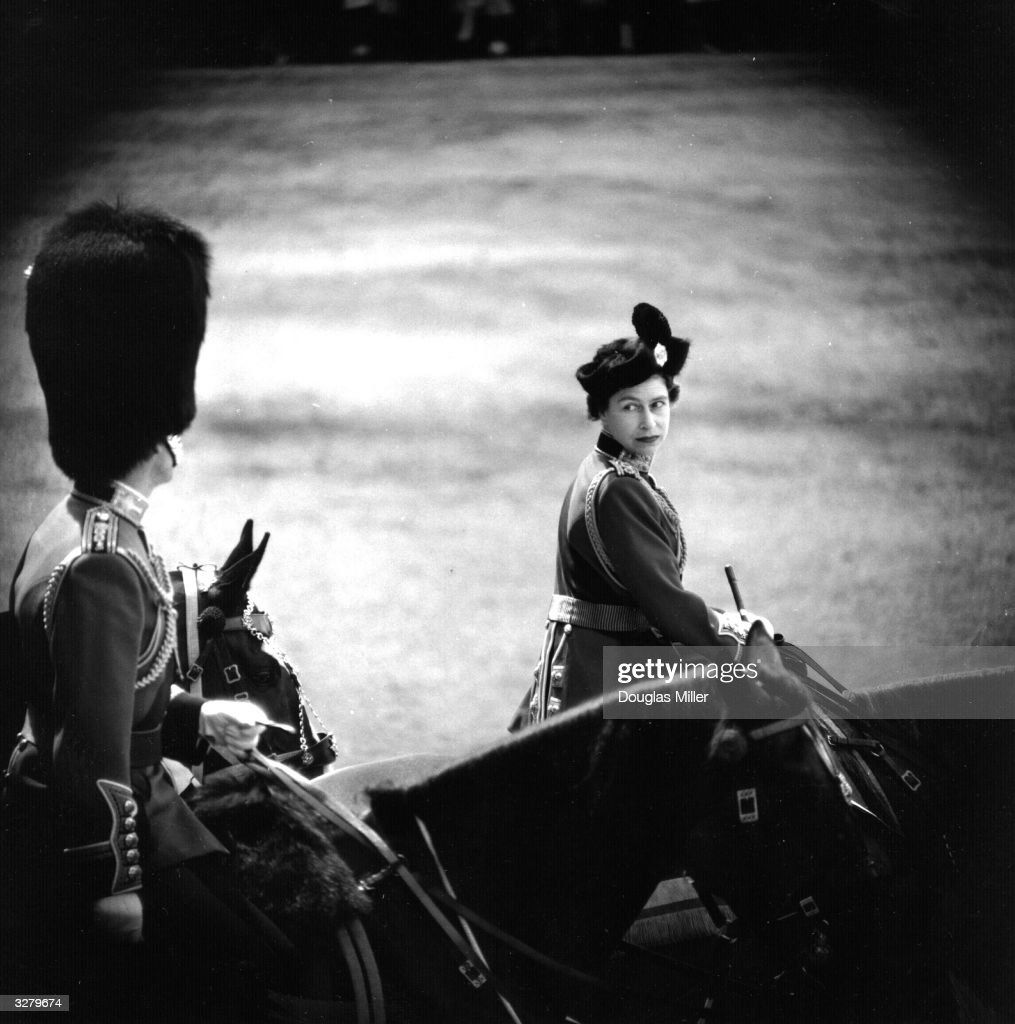 Queen Elizabeth II and Prince Philip, Duke of Edinburgh on horseback during a Trooping of the Colour ceremony at Horse Guards Parade, London commemorating the Queen's official birthday.