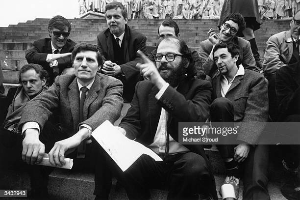 American beat poet Allen Ginsberg with a group of beat poets at the Albert Memorial in London