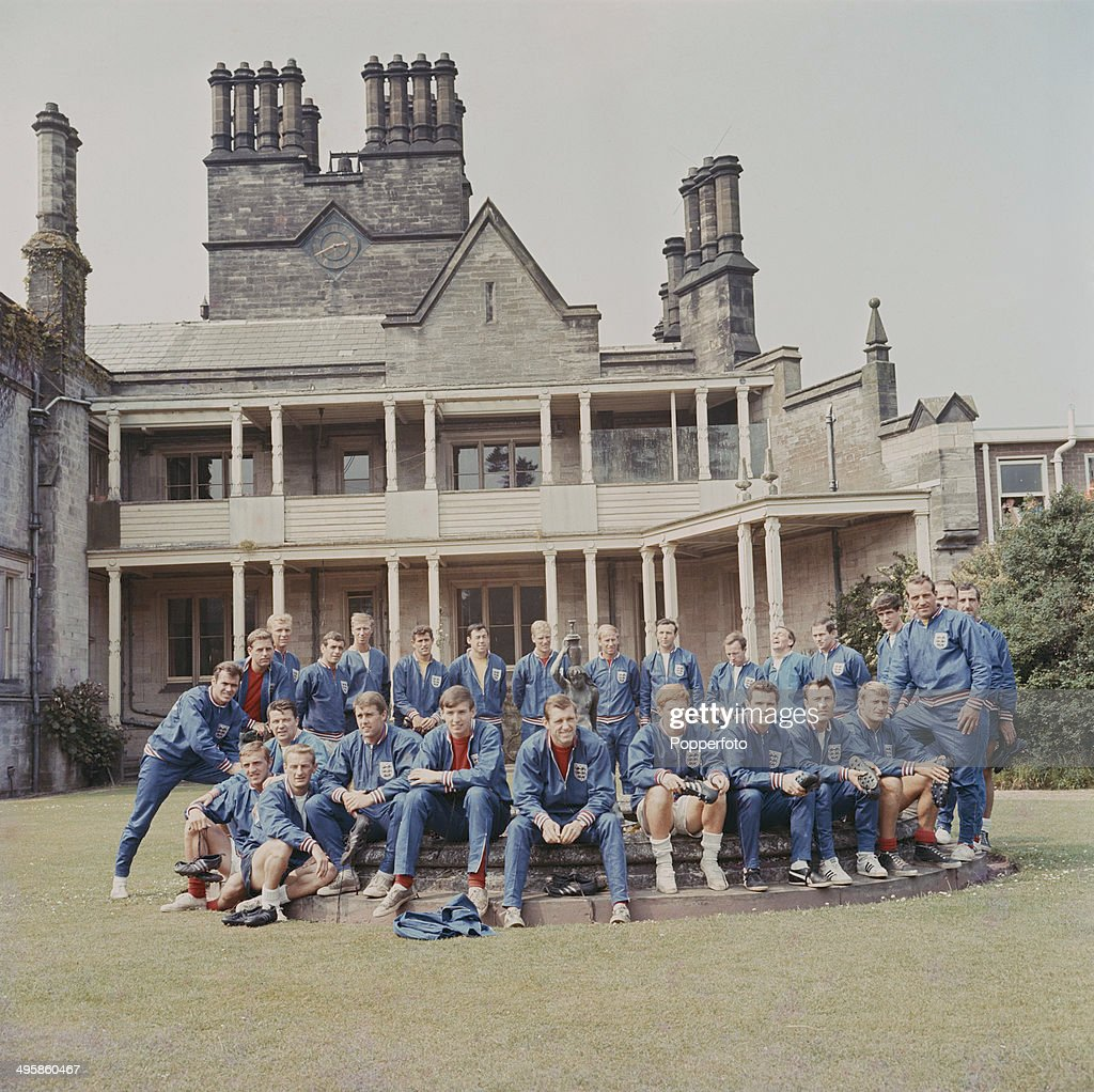The England 1966 World Cup football squad and training staff posed together outside the National Recreation Centre at Lilleshall, Shropshire on 10th June 1966. Back row clockwise from left: John Connelly, Gordon Milne, Bobby Moore, Ian Callaghan, Jack Charlton, Peter Bonetti, Gordon Banks, Ron Flowers, Bobby Charlton, Jimmy Armfield, Nobby Stiles, Les Cocker, Will McGuinness, Norman Hunter, Gerry Byrne, George Cohen and Ron Springett. Front row from left: Peter Thompson, George Eastham, Johnny Byrne, Geoff Hurst, Martin Peters, Keith Newton, Alan Ball, Terry Paine, Jimmy Greaves and Roger Hunt.