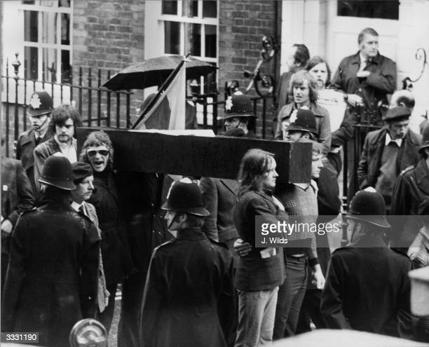 Carrying a replica coffin of the Irish Republican Army hunger striker Michael Gaughan, who died in Parkhurst Prison, crowds march from Hyde Park to...