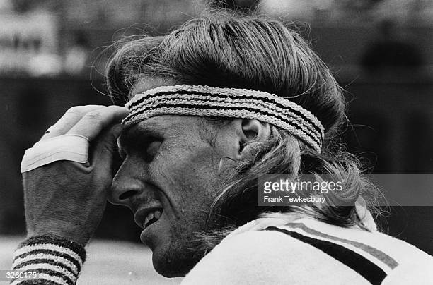 Bjorn Borg of Sweden adjusts his headband between games at the Wimbledon Tennis Championships He went on to win the men's singles title for the fifth...