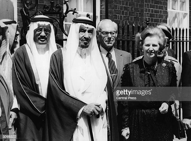 British Conservative Prime Minister Margaret Thatcher meets King Khalid of Saudi Arabia on the steps of 10 Downing Street with her husband Denis
