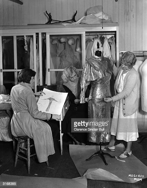 Three assistants of the famous American costume designer Adrian. He was contracted to MGM from 1927 to 1942 and defined the look of screen icons such...