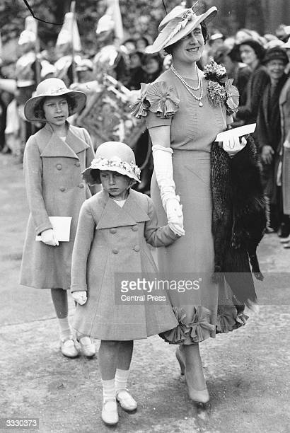 Elizabeth Duchess of York with her daughters Princesses Elizabeth and Margaret Rose arriving at Glamis Castle Angus to present Colours to the 4th and...