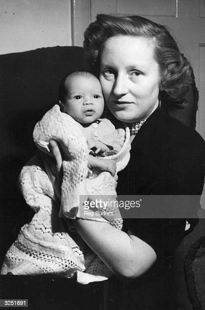 Ruth Khama with her baby Seretse son of exiled chief Seretse Khama of the Bamangwato tribe of Bechuanaland at the couple's Surrey home