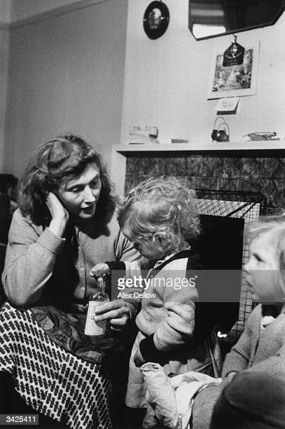 Housewife Annie Driver from Hunstanton Norfolk plays with two of her children at home Original Publication Picture Post 8285 Motherhood The Job With...