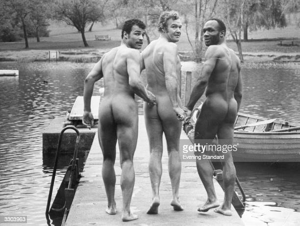Boxers John Conteh and Bunny Johnson with manager George Francis about to take a swim in Highgate Ponds