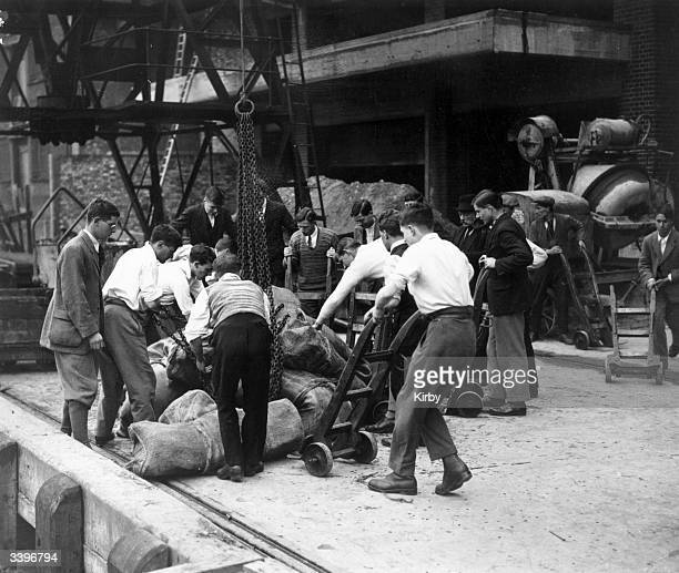 A replacement workforce at Hayes Wharf London Bridge unload sacks of bacon on the seventh day of the General Strike called by the Trades Union...