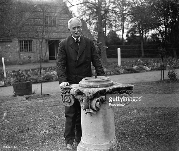 10th May 1930 Oxford England John Masefield the British Poet Laureate pictured in the garden of his home in Oxford next to a sundial