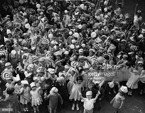 Children from Torrindon Road London County Council School at Catford enjoying a party to celebrate the Silver Jubilee of King George V and Queen Mary