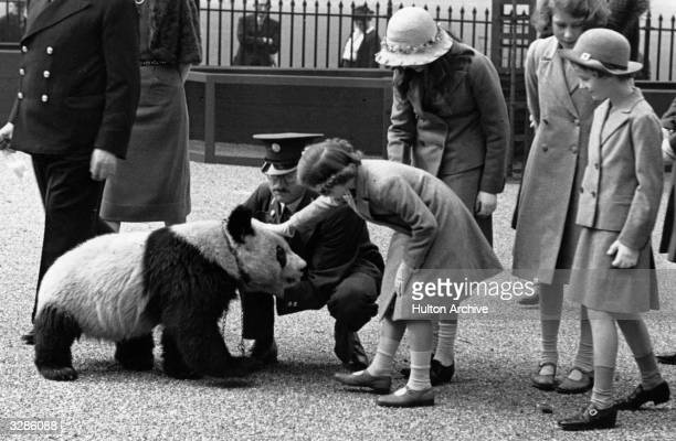 Princess Margaret Rose and Queen Elizabeth II enjoy a visit to the zoo