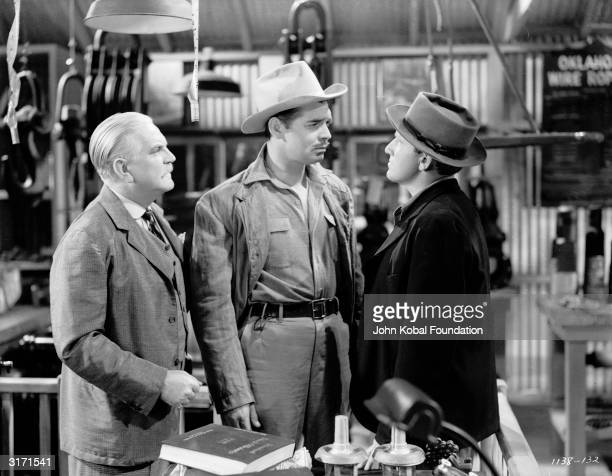 From left to right, Frank Morgan , Clark Gable and Spencer Tracy are the volatile stars of 'Boom Town', directed by Jack Conway.
