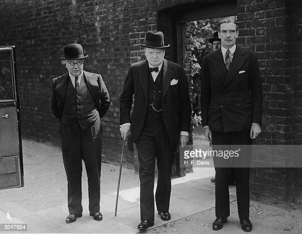 Winston Churchill leaving a cabinet meeting at 10 Downing Street after his appointment as Prime Minister With him are Air Minister Sir Kingsley Wood...
