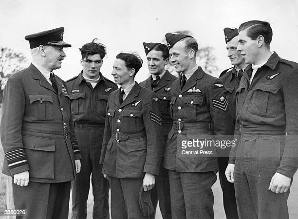 Air marshal Sir Arthur Harris commanderinchief of Bomber Command talks to six airmen members of an air crew rescued after 16 hours in a dinghy in the...