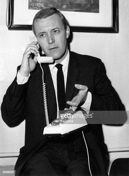 Postmaster General Anthony Wedgwood Benn tries out a luxury 'Trimphone' at Hampstead Town Hall It has an illuminated dial and the handset rests along...