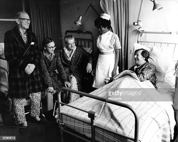 Labour MP and Social Services Secretary David Ennals in bed at Gordon Hospital London for a hernia operation shares a joke with other patients