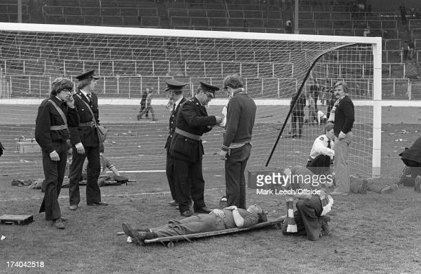 10th May 1980 Scottish FA Cup Final Celtic v Rangers Ambulancemen treat the injured after Celtic and Rangers fans had clashed after Celtic's 10...