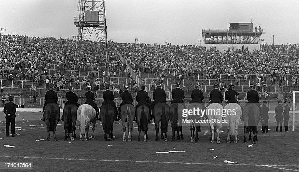10th May 1980 Scottish FA Cup Final Celtic v Rangers Hampden Park is cleared bt police horses after the pitch invasion by Celtic fans celebrating...