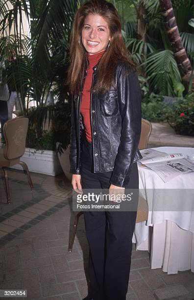 Fulllength image of American actor Debra Messing Beverly Hills California She wears a red turtleneck under a black leather jacket She was promoting...