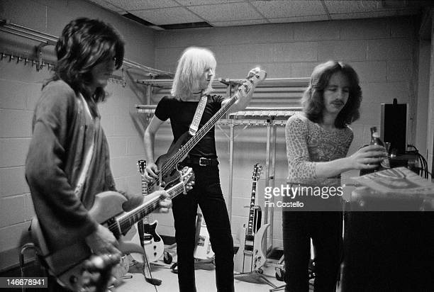 Joe Perry Tom Hamilton and guitarist Brad Whitford from Aerosmith tune up backstage before their concert at Madison Square Garden in New York on 10th...