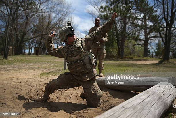 A 10th Mountain Division soldier hurls an unarmed hand grenade during a training exercise for future conflicts on May 18 2016 at Fort Drum New York...