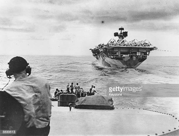 A US destroyer approaches an aircraft carrier during the Manila offensive in the Philippines Original Publication The radar antennas have been...