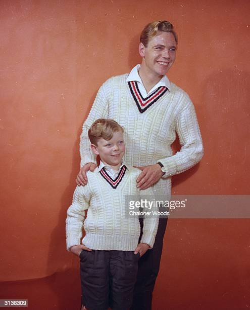 Father and son in long sleeved white cricketing sweaters in fancy rib with coloured inset round the vneck Bestway knitwear