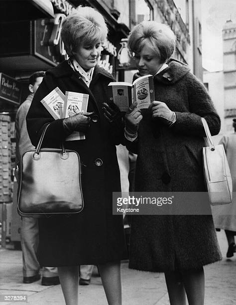 Two women outside a book shop in Leicester Square London with paperback copies of 'Lady Chatterley's Lover' by D H Lawrence after a jury at the Old...