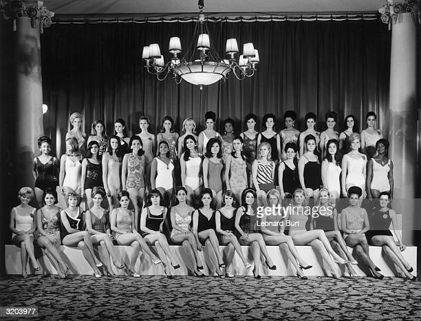 The contestants in the 1967 Miss World contest line up at the Lyceum Ballroom in London Third from the left in the back row is Madeleine Hartog Bell...
