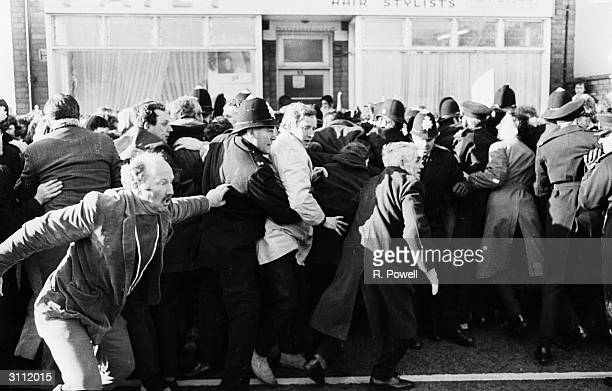 An antiapartheid demonstrators and policemen in a scuffle outside the ground where Midland Counties are playing the Springboks