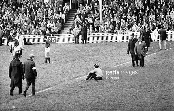 Police at a Springboks versus Miidland Counties rugger match after anti-apartheid demonstrators invaded the pitch.