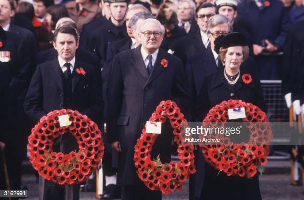 From left to right Liberal Party leader David Steel former Labour leader James Callaghan and Conservative prime minister Margaret Thatcher carrying...