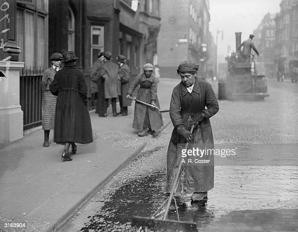 Women working on the tarring and flinting of Oxford Street London
