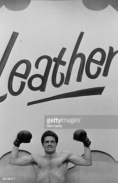British boxer Freddie Mills shows how tough and hard wearing he can be as he promotes leather at the National Leather Week Exhibition at Earls Court...