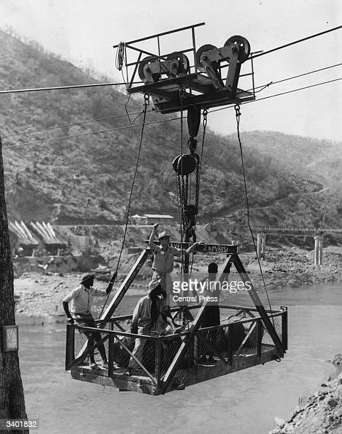 A hoist for carrying vehicles heavy machinery and workers across the Zambezi River during the construction of the Kariba Dam a hydroelectric facility...