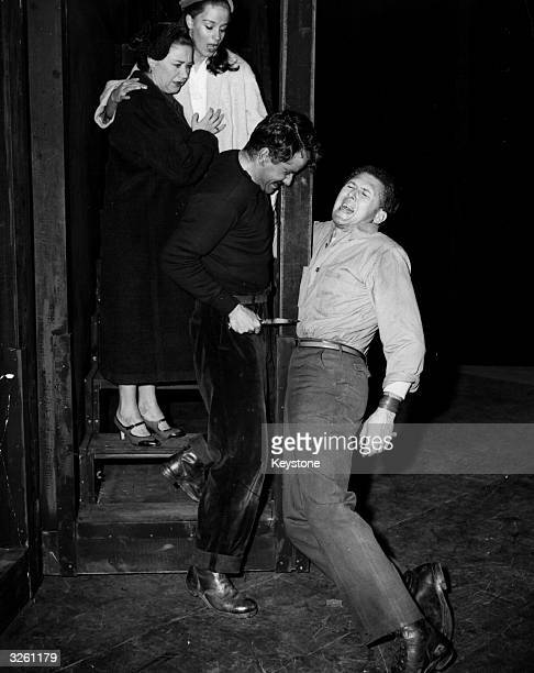 The English actor and director Sir Anthony Quayle during a rehearsal of Arthur Miller's play 'A View from the Bridge' at the Comedy Theatre, London....