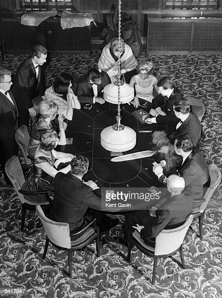 Playing Chemin de fer a form of baccarat in a gaming room at the Playboy Club an exclusive residential country club in Barnet north London No...