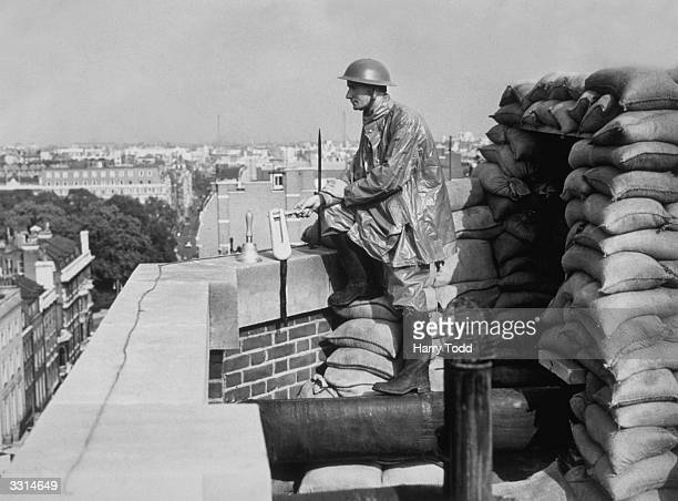 An ARP warden on the roof of the Grosvenor House Hotel Many London hotels had extensive ARP constructions to ensure guests remained safe and...
