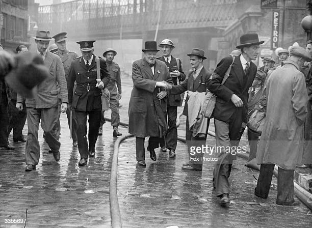 British Prime Minister Winston Churchill on a tour of bomb damage in the City of London.