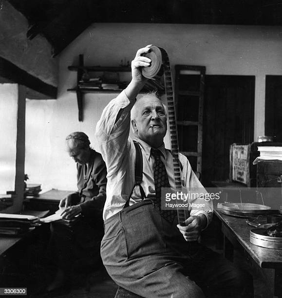 US film director Robert Flaherty who directed the film 'Man of Aran' in 1934 looking at some film during his return visit to the Aran Islands in...