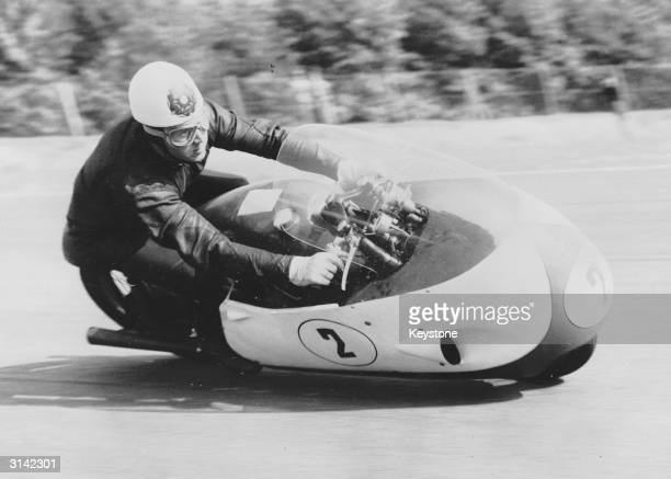 British motorcyclist and racing driver Geoff Duke practicing for the Grand Prix at the famous Monza track near Milan