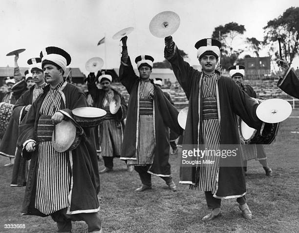 Members of the Mehter Turkish Army Band wearing traditional costumes of the Ottoman Empire era rehearse for their display at the Woolwich Searchlight...