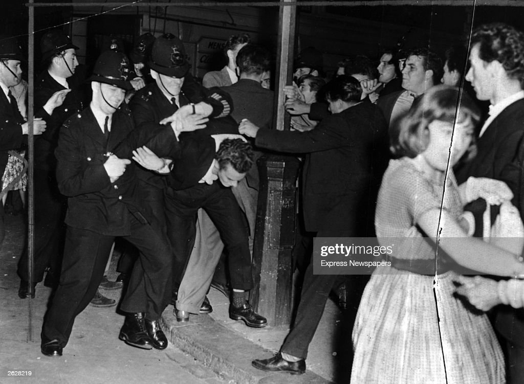 White youth clash with British police during the Notting Hill race riots in London.