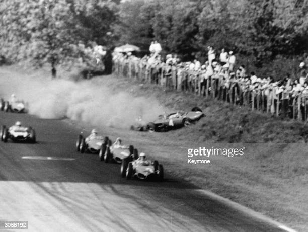 The Ferrari of Wolfgang von Trips is about to crash into the crowd during the disaster at Monza The car in the lead is No2 driven by Phil Hill who...