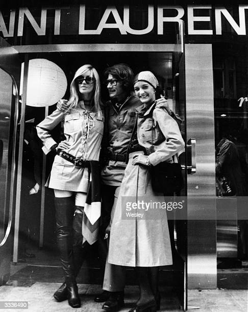 The French couturier Yves Saint Laurent is flanked by Betty Catroux and Loulou de la Falaise outside his new shop in New Bond Street London