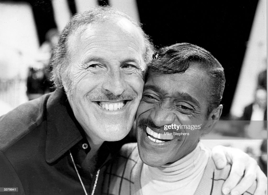 Popular British entertainer Bruce Forsyth, with singer and dancer Sammy Davis Jnr (1925 - 1990), who will be appearing together on a special one hour spectacular at the South Bank London Weekend Television Centre in London.