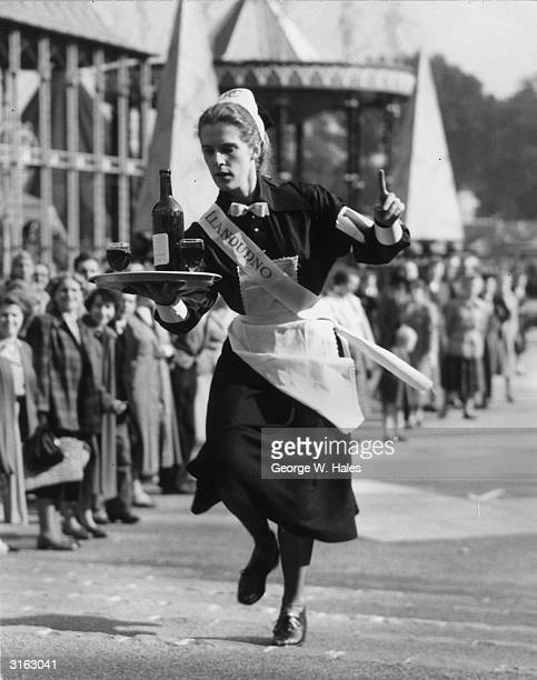 Waitress Enid Soffe from Llandudno competing in the annual waitress races held at Battersea Park Pleasure Gardens